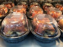 Roasted Chickens. Roasted Chickens Being cooked in a shop roaster in a Sam`s warehouse store royalty free stock photography