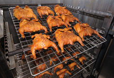 Roasted chickens in the oven Stock Images