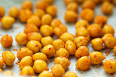 Roasted chickpeas on a baking tray Royalty Free Stock Image