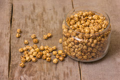 Roasted chickpeas. In a bowl on a wooden background stock photos