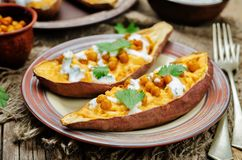 Roasted chickpeas stuffed sweet potato with Greek yogurt cilantr Royalty Free Stock Image