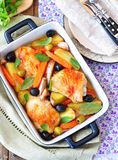 Roasted chiken legs with vegetables and olives Royalty Free Stock Photos
