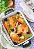Roasted chiken legs with vegetables and olives Royalty Free Stock Images