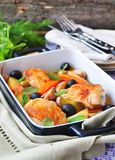 Roasted chiken legs with vegetables and olives Stock Photos