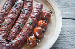 Roasted chorizo with cherry tomatoes Royalty Free Stock Images