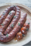 Roasted chorizo with cherry tomatoes Stock Photography