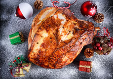 Roasted Christmas ham on board with festive decoration. top view, background Stock Image