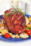 Roasted christmas ham. With orange slices and vegetables Royalty Free Stock Photo