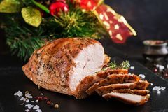 Roasted Christmas ham of turkey on dark rustic background. Roasted sliced Christmas ham of turkey on dark rustic background. Festival food royalty free stock images