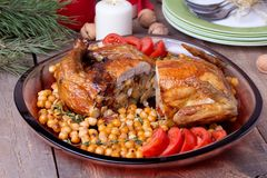Roasted Christmas whole chicken with chickpeas Royalty Free Stock Photography