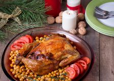 Roasted Christmas whole chicken with chickpeas Royalty Free Stock Photo
