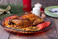 Roasted Christmas whole chicken with chickpeas Stock Photography