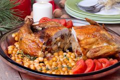 Roasted Christmas whole chicken with chickpeas Royalty Free Stock Image