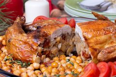 Roasted Christmas whole chicken with chickpeas Royalty Free Stock Photos
