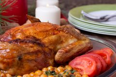 Roasted Christmas whole chicken with chickpeas Stock Images
