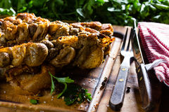 Roasted chunchules rellenos. Typical Latin American Chilean and argentine food. Royalty Free Stock Photos