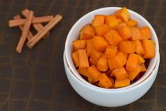 Roasted cinnamon pumpkin. Homemade roasted cubed cinnamon pumpkin Royalty Free Stock Images