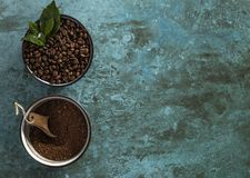 Roasted And Coarse Grinded Coffee Beans Coffea Arabnica. A stillife shot of the product from the coffea arabica plant, divided into to as roasted coffee beans Royalty Free Stock Image