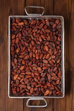 Roasted cocoa chocolate beans in Vintage heavy cast aluminum roa Royalty Free Stock Image