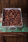 Roasted cocoa chocolate beans in Vintage heavy cast aluminum roa Stock Photos