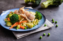Roasted cod rolls with millet and steamed vegetable Stock Photo