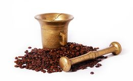 Roasted coffee and ancient brazen pounder Stock Photo