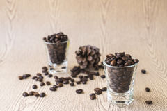 Roasted coffee bean in coffee shot glass Stock Photos