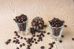 Roasted coffee bean in coffee shot glass Stock Photography