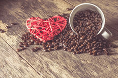 Roasted coffee bean with heart icon Stock Images