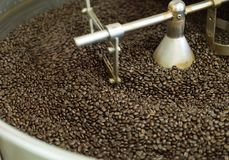 Roasted coffee bean in machine Royalty Free Stock Photo