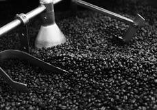 Roasted coffee bean in machine Stock Photo