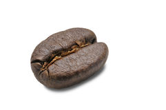 A roasted coffee bean. A macro photograph of a roasted coffee bean on a white background Royalty Free Stock Image
