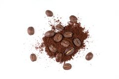 Roasted coffee bean with powder on white background. Roasted coffee bean with powder isolated on white background royalty free stock image