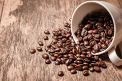 Roasted coffee bean in white cup Stock Photos