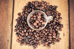 Roasted coffee bean on wood table Royalty Free Stock Photography