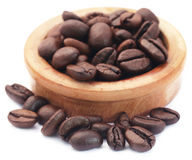 Roasted coffee bean in a wooden bowl Stock Images