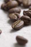 Roasted coffee beans. On jute sacking Stock Photo
