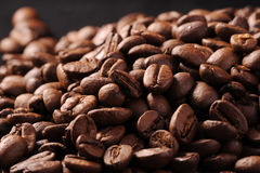 Roasted coffee beans. Pile of roasted coffee beans with black background Royalty Free Stock Photo