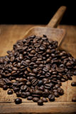 Roasted coffee beans. On old wooden table Stock Photo