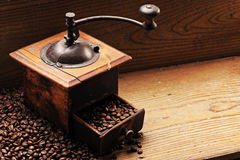 Roasted coffee beans. Are ground in a coffee grinder stock photos