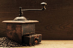 Roasted coffee beans. Are ground in a coffee grinder stock photography