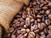 Roasted coffee beans. Closeup of cofee beans in burlap sack Stock Image