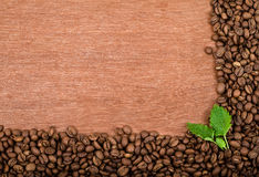 Roasted coffee beans. On wooden background Stock Image