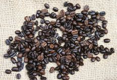 Roasted Coffee Beans. Roasted organic coffee beans on hemp Stock Photo