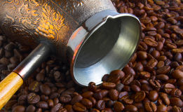 Roasted coffee beans. A closeup view of freshly roasted coffee beans and a fancy, decorated scoop Stock Photos