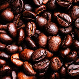 Roasted coffee beans as a background. Coffee bean wallpaper macro royalty free stock photo