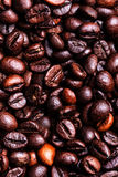 Roasted coffee beans as a background. Coffee bean wallpaper macro. Up royalty free stock photos