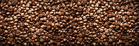 Roasted coffee beans backgound, copy space, top view. Cappuccino, dark espresso, aroma black caffeine drink, ingredient. For coffee beverage. Banner Stock Photography