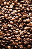 Roasted coffee beans backgound, copy space, top view. Cappuccino, dark espresso, aroma black caffeine drink, ingredient. For coffee beverage Stock Photography