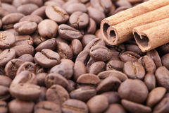 Roasted coffee beans background with cinnamon. Close up roasted coffee beans background with cinnamon Stock Images